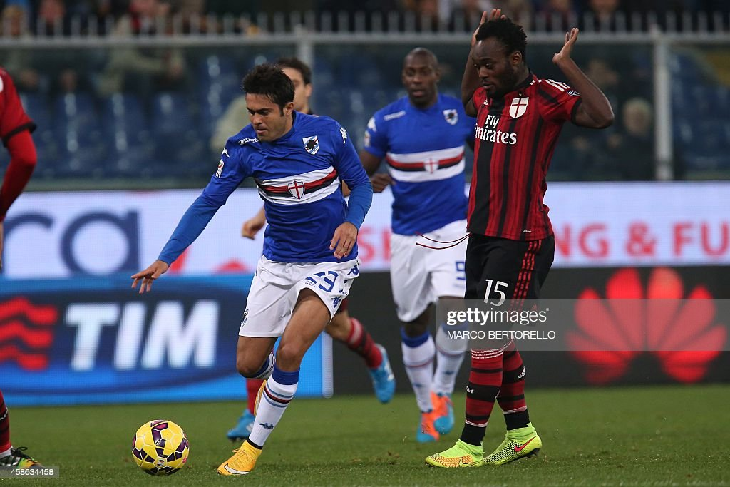 Sampdoria's Brazilian forward Citadin Martins Eder fights for the ball with AC Milan's midfielder Michael Essien from Ghana during the Italian Serie A football match Sampdoria Vs AC Milan on November 8, 2014 at Luigi Ferraris Stadium in Genoa.