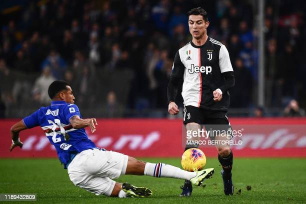 Sampdoria's Colombian defender Jeison Murillo tackles Juventus' Portuguese forward Cristiano Ronaldo during the Italian Serie A football match...