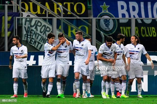 Sampdoria's Czech forward Patrik Schick is congratulated bteammates after scoring a goal during the Italian Serie A football match between Inter...