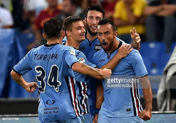 Sampdoria's forward Fabio Quagliarella celebrates with teammates after scoring during the Italian Serie A football match As Roma versus Sampdoria on...