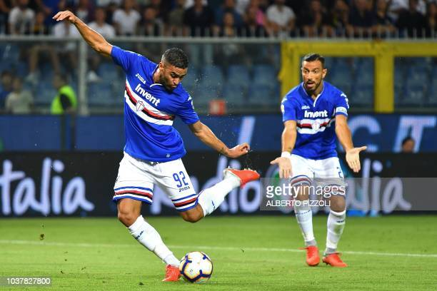 Sampdoria's French forward Gregoire Defrel kicks the ball past teammate Italian forward Fabio Quagliarella during the Italian Serie A football match...