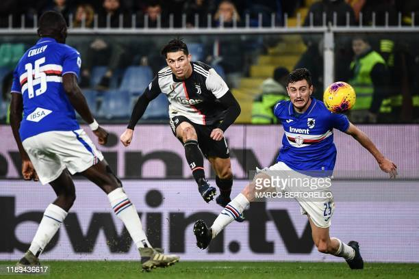 Sampdoria's Gambian defender Omar Colley, Juventus' Portuguese forward Cristiano Ronaldo and Sampdoria's Italian defender Alex Ferrari go for the...