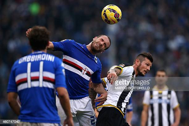 Sampdoria's Italian defender Lorenzo De Silvestri heads the ball with Udinese's French forward Cyril Thereau during the Italian Serie A football...