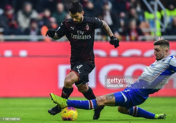 Sampdoria's Italian defender Nicola Murru tackles AC Milan's Spanish forward Suso during the Italian Serie A football match AC Milan vs Sampdoria on...
