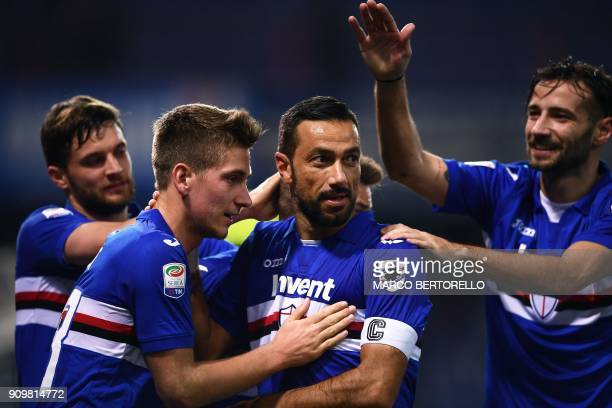 Sampdoria's Italian forward Fabio Quagliarella celebrates with teammates after scoring a goal during the Italian Serie A football match between...