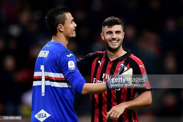 Sampdoria's Italian goalkeeper Emil Audero chats with AC Milan's forward Patrick Cutrone from Italy during the Italian Serie A football match AC...