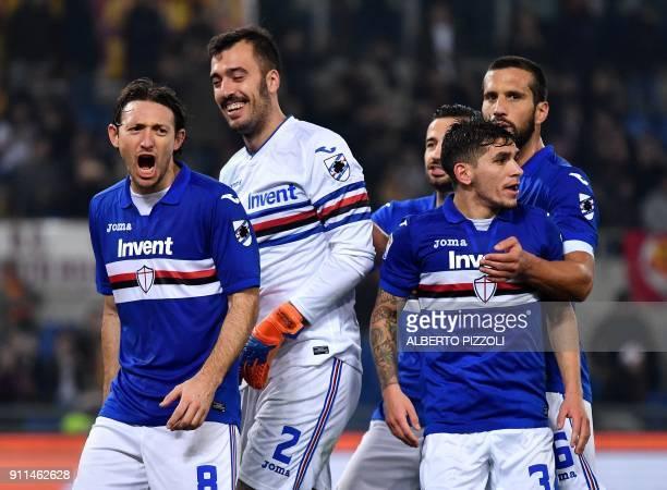 Sampdoria's Italian goalkeeper Emiliano Viviano is congratulated by teammates after saving a penalty kick during the Italian Serie A football match...