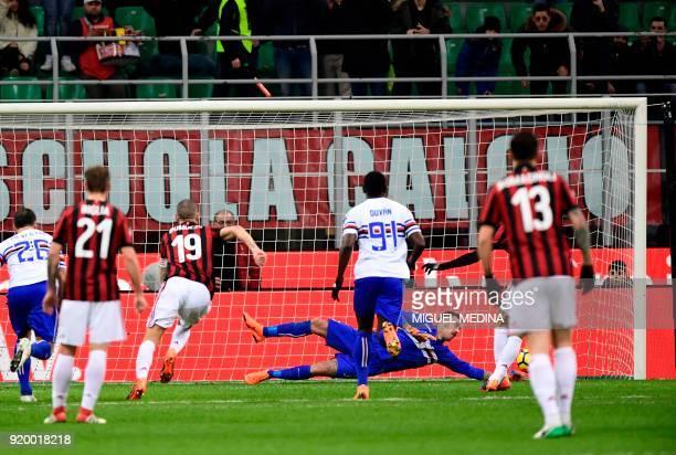 Sampdoria's Italian goalkeeper Emiliano Viviano stops a penalty kicked by AC Milan's Captain Italian defender Leonardo Bonucci during the Italian...
