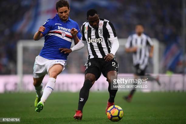 Sampdoria's midfielder Bartosz Bereszynski from Poland fights for the ball with Juventus' midfielder Kwadwo Asamoah from Ghana during the Italian...