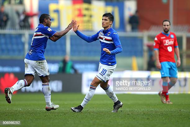 Sampdoria's midfielder Joaquin Correa from Argentina celebrates after scoring with teammate Fernando from Brazil during the Italian Serie A football...