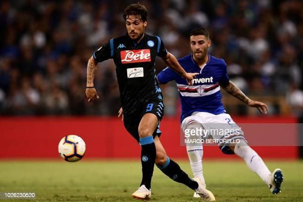 Sampdoria's midfielder Karol Linetty from Poland vies for the ball with Napoli's Italian forward Simone Verdi during the Italian Serie A football...