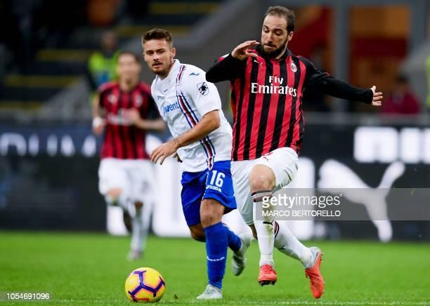 Sampdoria's Poland midfielder Karol Linetty vies for the ball with AC Milan's Argentinian forward Gonzalo Higuain during the Italian Serie A football...