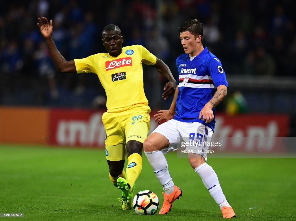 Sampdoria's Polish forward Dawid Kownacki (R) vies with Napoli's French defender Kalidou Koulibaly during the Italian Serie A football match Sampdoria vs Napoli on May 13, 2018 at the Luigi Ferraris stadium in Genova. (Photo by MIGUEL MEDINA / AFP) / The erroneous mention[s] appearing in the metadata of this photo by Miguel MEDINA has been modified in AFP systems in the following manner: [May 13] instead of [April 13]. Please immediately remove the erroneous mention[s] from all your online services and delete it (them) from your servers. If you have been authorized by AFP to distribute it (them) to third parties, please ensure that the same actions are carried out by them. Failure to promptly comply with these instructions will entail liability on your part for any continued or post notification usage. Therefore we thank you very much for all your attention and prompt action. We are sorry for the inconvenience this notification may cause and remain at your disposal for any further information you may require.