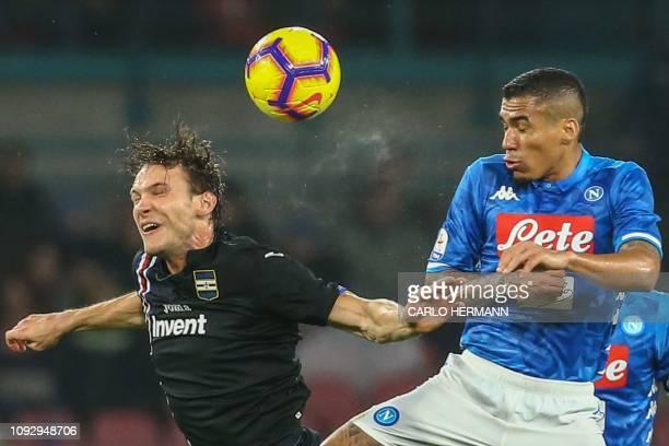 Sampdoria's Swiss midfielder Albin Ekdal and Napoli's Brazilian midfielder Allan go for a header during the Italian Serie A football match Napoli vs...