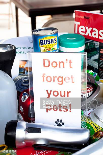 sample of emergency prepardness items and pet reminder - disaster relief stock photos and pictures