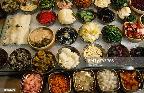 a sample of pickles, an integral part of every japanese meal- nishiki-koji market, kyoto, japan - nishiki market stock photos and pictures