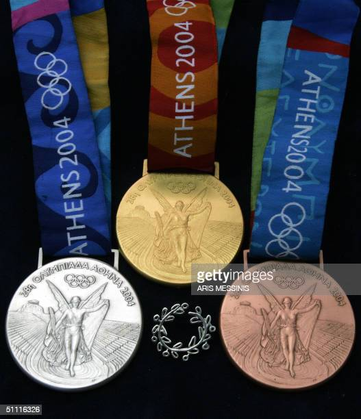 A sample of the Olympic medals is seen during a presentation at the factory where they are made in Aspropyrgos a western suburb of Athens 26 July...