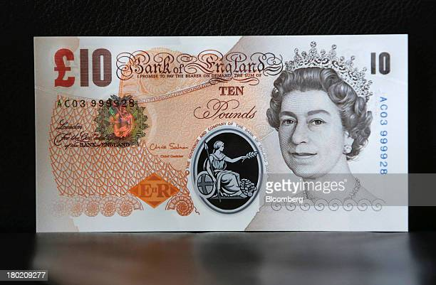 A sample Polymer ten pound British banknote sits on display during a news conference at the Bank of England in London UK on Tuesday Sept 10 2013 Bank...