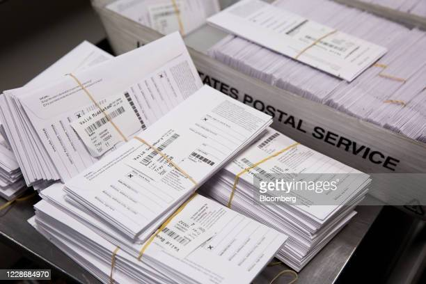 Sample voting ballots sit in a pile during a training on a new ballot sorting machine at the Board of Elections in Doylestown, Pennsylvania, U.S., on...