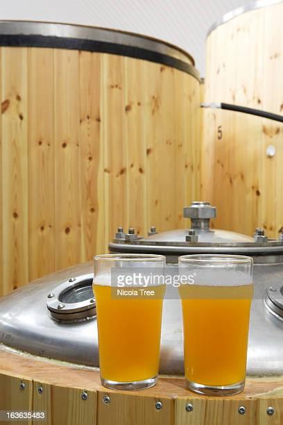 samples of Beer on top of fermentation tanks