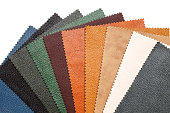 Samples of natural, textured, multi-colored leather. Top view.