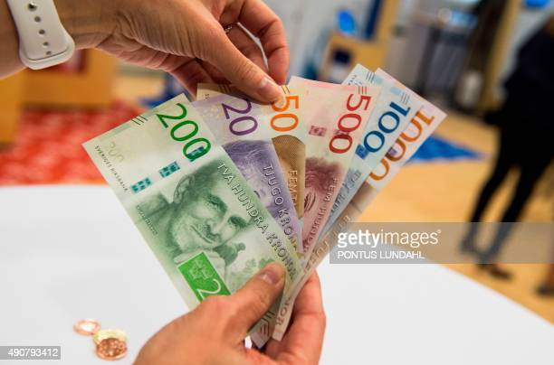 Samples of new Swedish bank notes are seen at a press conference in Stockholm on October 1 2015 Thursday saw the biggest switch in bank notes and...