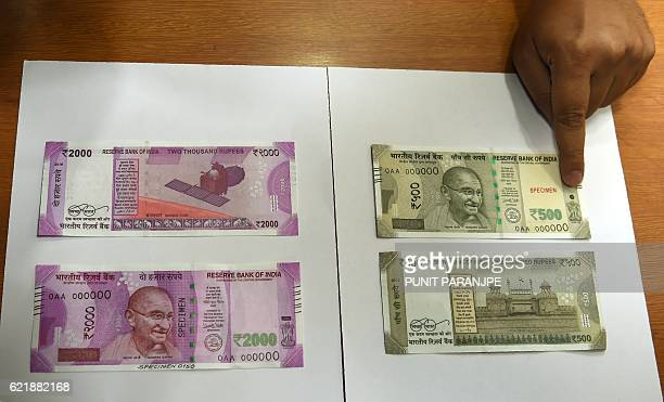 Samples of the new 500 and 2000 INR notes are displayed at the Reserve Bank of India headquarters in Mumbai on November 9 2016 India's government...