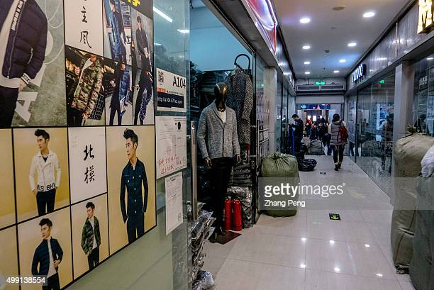 Sample's posters are pasted on the shop windows in an ecommerce base in Hangzhou where wholesalers supply clothes goods for Taobao shop owners Taobao...