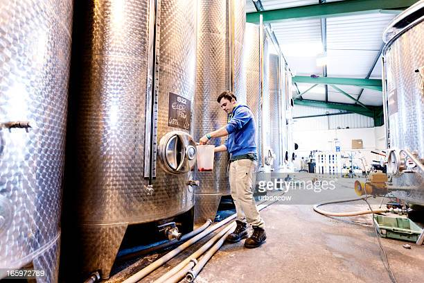 sampling fermentation tanks - storage tank stock photos and pictures