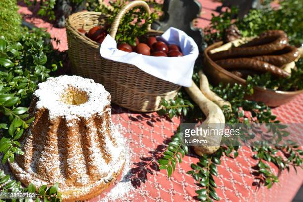 A sampling of traditional Easter food are brought outside Mariacki Basilica in Krakow to be blessed on Holy Saturday by the Archbishop of Krakow...