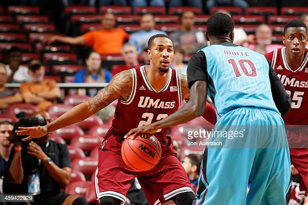 Sampson Carter of the Massachusetts Minutemen defends against Okaro White of the Florida State Seminoles during the MetroPCS Orange Bowl Basketball...