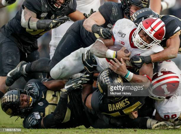 Sampson James of the Indiana Hoosiers is tackled by the Purdue Boilermakers in the first half at Ross-Ade Stadium on November 30, 2019 in West...