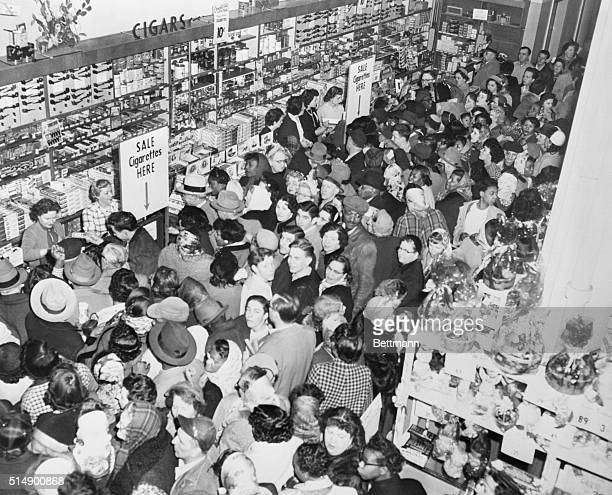 Sam's Sale Draws Bargain Hunters by the Hundreds Detroit Michigan Such bargains as popular brand cigarets for ten cents the pack and nylon stockings...