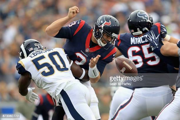 Samson Ebukam of the Los Angeles Rams knocks the ball loose from Tom Savage of the Houston Texans causing a fumble during the second half of game at...