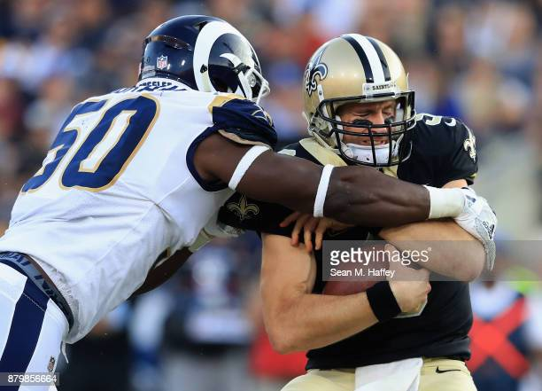 Samson Ebukam of the Los Angeles Rams sacks Drew Brees of the New Orleans Saints during the second half of a game at Los Angeles Memorial Coliseum on...