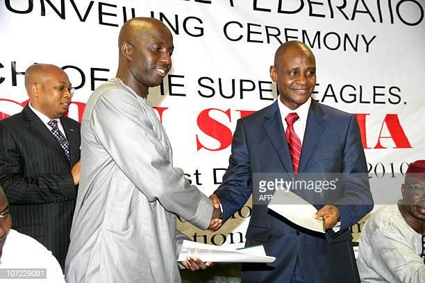Samson Siasia the new coach of Nigeria's national football team the Super Eagles shakes hands with Alhaji Aminu Maigari Nigerian Football Federation...