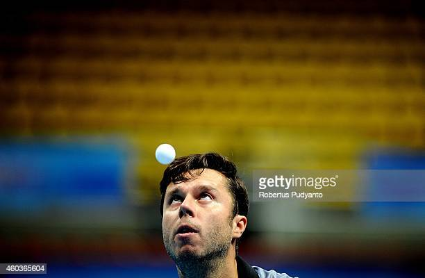 Samsonov Vladimir of Belarus in action during the Men's singles round of 16 of the 2014 ITTF World Tour Grand Finals at Huamark Indoor Stadium on...