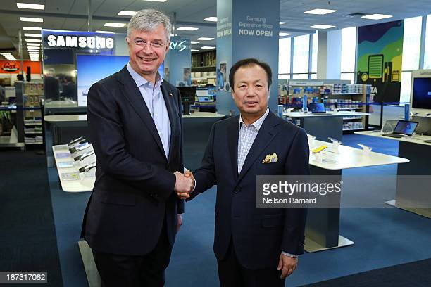 Samsung CEO and President of IT and Mobile Business JK Shin and Best Buy CEO Hubert Joly celebrate the opening of the Samsung Experience Shop at Best...