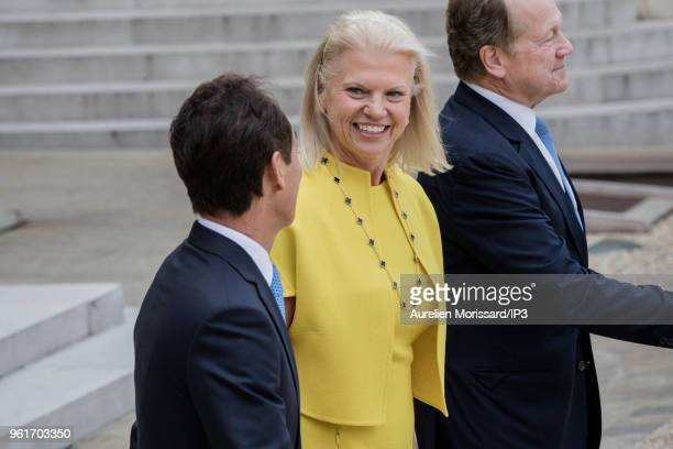 Samsung CEO Young Sohn and IBM CEO Virginia Rometty leave after the Tech for Good Summit at Elysee Palace on May 23 2018 in Paris France On the eve...