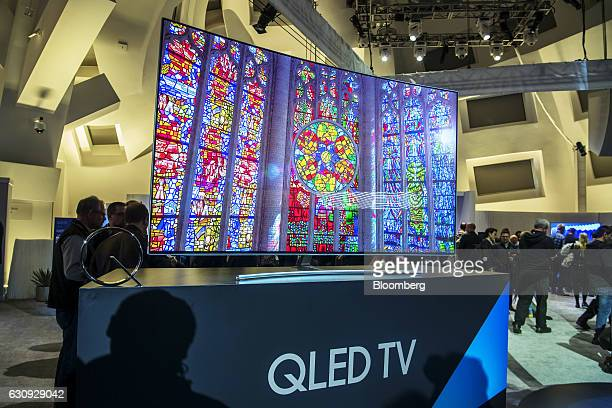 A Samsung Electronics Co 75Q8C QLED TV part of the Q8 series sits on display during a Samsung press event at the 2017 Consumer Electronics Show in...