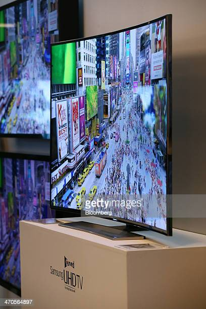 Samsung Electronics Co curved Ultra High Definition televisions are displayed at a media event in Seoul South Korea on Thursday Feb 20 2014 Samsung...
