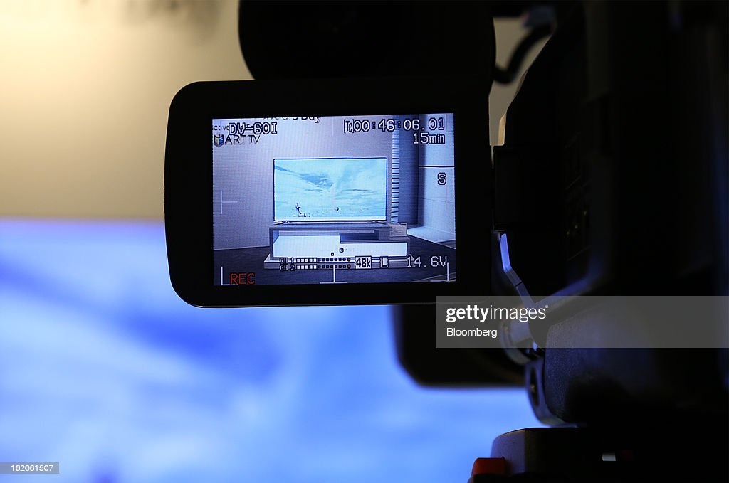 A Samsung Electronics Co. F8000 series smart television is seen through a camera viewfinder at a media event in Seoul, South Korea, on Tuesday, Feb. 19, 2013. Samsung Electronics Co., the world's largest television maker, targets to start selling TVs using a technology allowing brighter and sharper images in the first half to extend its market lead. Photographer: SeongJoon Cho/Bloomberg via Getty Images