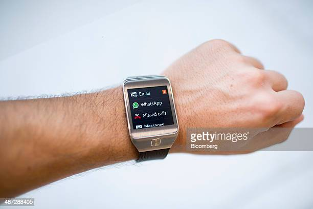 A Samsung Electronics Co Galaxy Gear 2 Neo smartwatch is arranged for a photograph at a Samsung retail store in the Central district of Hong Kong...