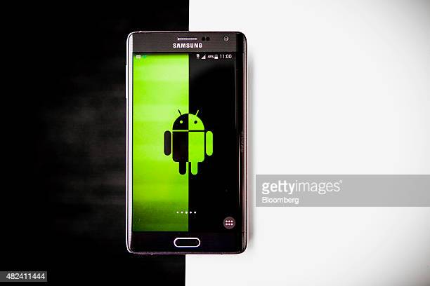 A Samsung Electronics Co Galaxy Note Edge smartphone running the Android mobile operating system is arranged for a photograph in New York US on...
