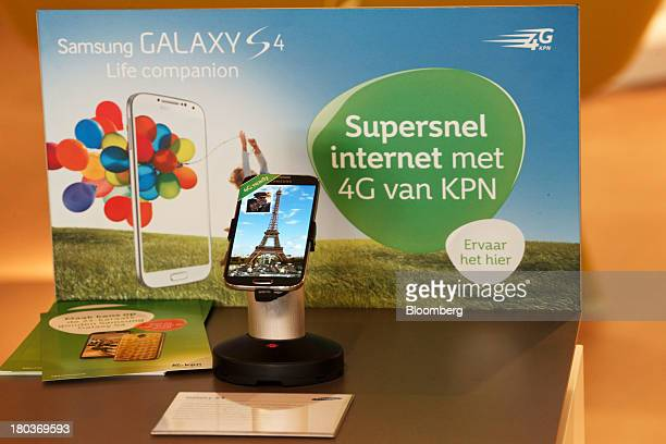 Samsung Electronics Co. Galaxy S4 smartphone sits on display in front of a 4G service sign inside a KPN XL store, operated by Royal KPN NV, in The...