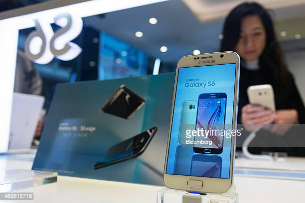 A Samsung Electronics Co Galaxy S6 smartphone sits on display during a launch event at a Samsung Partnershop retail store in Hong Kong China on...