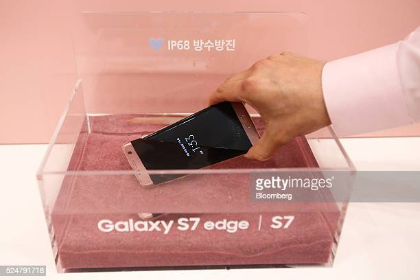 A Samsung Electronics Co Galaxy S7 smartphone is submerged in water during a demonstration at one of the company's promotion booths in Seoul South...