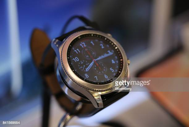 A Samsung Electronics Co Gear S3 smartwatch sits on display inside a Mobile TeleSystems PJSC mobile communications store in Moscow Russia on Friday...