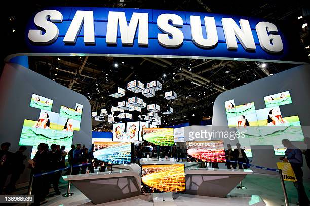 A Samsung Electronics Co logo hangs above the company's booth during the 2012 International Consumer Electronics Show in Las Vegas Nevada US on...