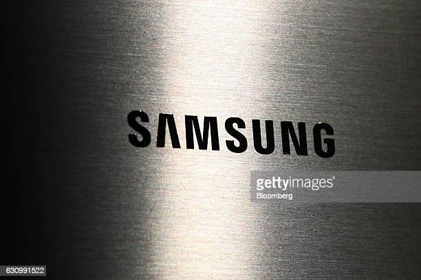 A Samsung Electronics Co logo is seen on the company's product displayed at the company's D'light flagship store in Seoul South Korea on Wednesday...